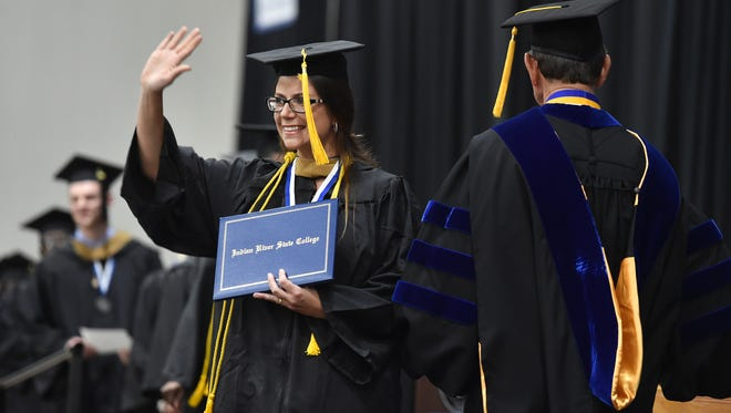 Danielle Brecher, of Stuart, celebrates graduating from Indian River State College, from the stage at the Havert L. Fenn Center, during the second IRSC Fall Commencement ceremony for bachelor's degree graduates Dec. 14, 2016, in Fort Pierce.