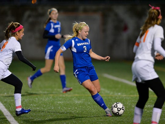 Sartell's Bria Ferns moves the ball up the field between St. Cloud Tech's Brenna Weaver, left,  and Susannah Froelich in the first half Tuesday evening, Sept. 27, at Husky Stadium.