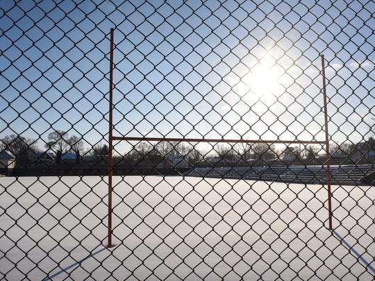 Late-afternoon sunshine highlights a goal post at Clark