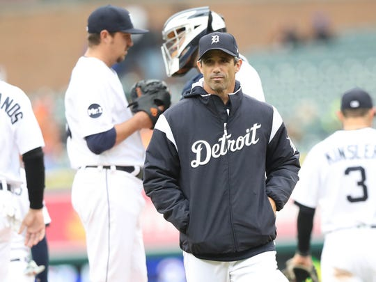 Tigers manager Brad Ausmus makes a pitching change during the sixth inning of the Tigers' 7-3 win Sunday at Comerica Park.