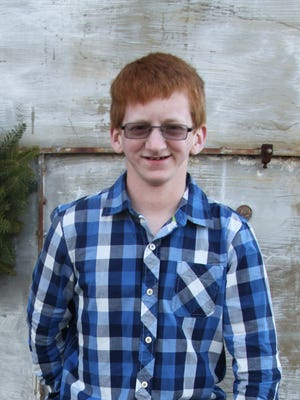 Justin Rabjohn, who was born on Christmas Day 1997, at his family's Christmas tree farm in Brockport.