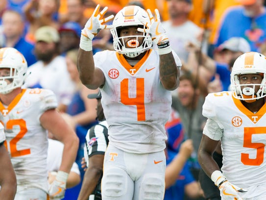 Tennessee running back John Kelly (4) reacts after