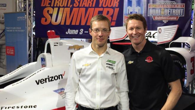 Drivers Sebastien Bourdais, left, and Scott Dixon toured the auto show.