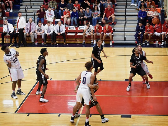 The Cedars' Khalique Washington drops in a foul shot to help Lebanon take a one-point lead in the fourth quarter during the Cedars' 51-50 win over CD East in the District 3 Class 6A Quarterfinals Friday evening, Feb. 24.