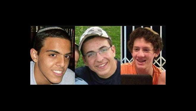 This undated file image released by the Israel Defense Forces shows a combination of three photos of Israeli teens Eyal Yifrah, 19, Gilad Shaar, 16, and Naftali Fraenkel, a 16-year-old with dual Israeli-American citizenship, who disappeared while hitchhiking home near the West Bank city of Hebron late at night on June 12, 2014, and were never heard from again.
