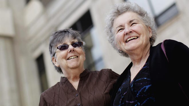 In this March 10, 2014 file photo, Jennie Rosenbrahn, left, and Nancy Rosenbrahn, two challengers of South Dakota's former same-sex marriage ban, stand outside the Pennington County Courthouse in Rapid City.