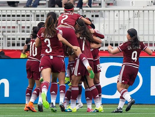 Mexico celebrates their goal against Colombia during the first half of a FIFA Women's World Cup soccer match in Moncton, New Brunswick, Canada, Tuesday, June 9, 2015. (Andrew Vaughan/The Canadian Press via AP) MANDATORY CREDIT