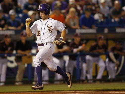 LSU infielder Cole Freeman scores during an SEC Tournament game last week.