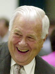 Bill Newman shakes hands after winning the Citizen of the Year award at the 83rd Anniversary Annual Meeting of the Henderson-Henderson County Chamber of Commerce Thursday night, April 13, 2000. The awards ceremony and dinner were held in the cafeteria at Holy Name School.