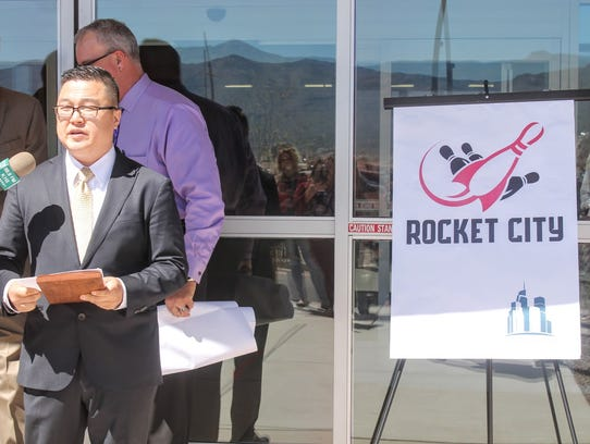 Downtown Venture Corp. CEO  Jay Chun unveiled the new logo and name Rocket City Fun Center for Basin Lanes during a ceremonial key exchange Monday.