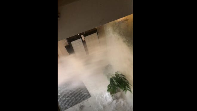 A burst water pipe on the ground floor of 329 Main St. shoots water into the lobby Monday, Jan. 8. 2018.