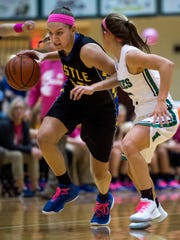 Castle's Jessica Nunge (30) dribbles as North's Anna Newman (1) defends her at North High School in Evansville, Ind., on Tuesday, Nov. 21, 2017. Castle won 60-35.