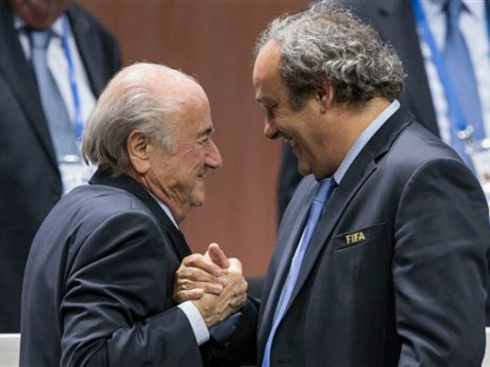 FILE - In this Friday, May 29, 2015 file photo, FIFA president Sepp Blatter after his election as President greeted by UEFA President Michel Platini, right, at the Hallenstadion in Zurich, Switzerland.