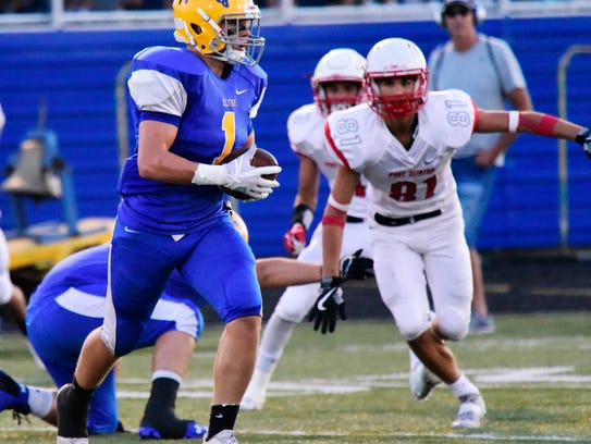 Port Clinton's Tim Paradiso chases Clyde's Conner Long. Both earned spots on the News-Messenger's defense.