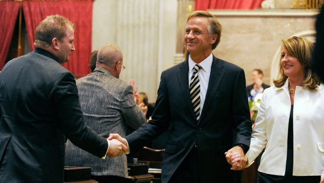 Gov. Bill Haslam and first lady Crissy Haslam leave the House chambers together after the governor gave his annual State of the State address in Nashville.