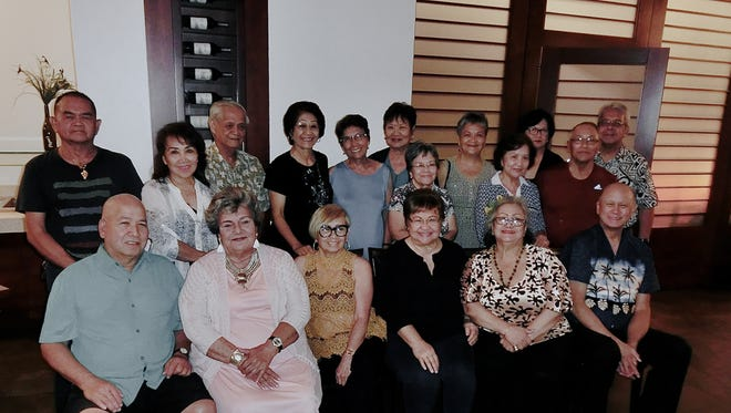 The Guam High School Class of 1965 held an impromptu dinner June 15 at Papa's Restaurant to bid farewell to Annie Delgado Duenas and Charlotte Ann Bordallo Perez. Sitting from left: Thomas Perez, Janis Ferrante, Annie Duenas, Juanita Camacho, secretary, Maryann Cabrera, treasurer and John Ray Taitano, president, Guam High School Class of 1965. Back row from left: Jesus Guerrero, Nat Iwashita, Alfred Cabrera, Sera Taitano, Lila Gombar, Bernie Terlaje, Rosa Loerzel, Anita Perez, Mrs. Blas, Charlotte Perez, John Blas, and Victor Perez.