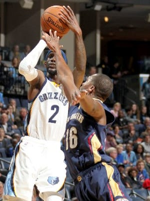 Memphis Grizzlies Briante Weber shoots defined by New Orleans Pelicans Toney Douglas during a game in March at FedExForum.