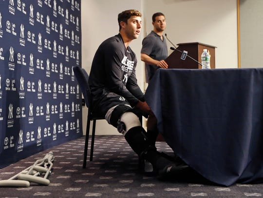 New York Yankees outfielder Dustin Fowler, left, speaks