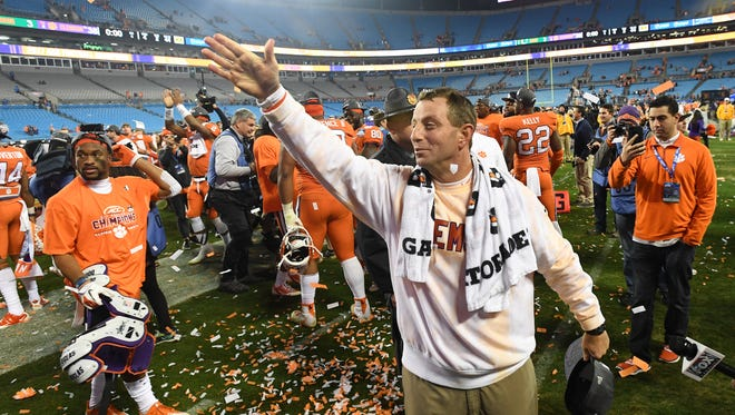 Clemson head coach Dabo Swinney celebrates after the Tigers 38-3 win over Miami in the ACC championship at Bank of America Stadium in Charlotte on Saturday, December 2, 2017.