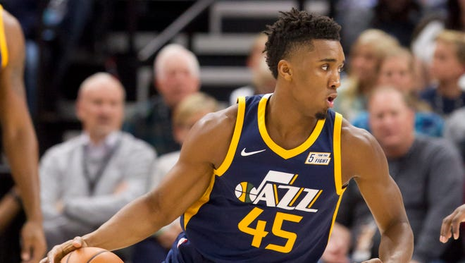 Utah Jazz guard and former Louisville standout Donovan Mitchell dribbles during a game against the Dallas Mavericks.