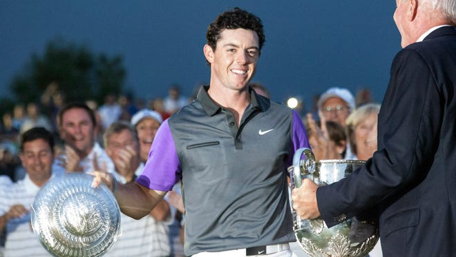 PGA Champion Rory McIlroy accepts the trophy for his victory at Valhalla.