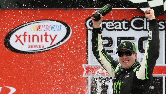 Kyle Busch, driver of the #54 Monster Energy Toyota, celebrates in victory lane after winning the NASCAR XFINITY Series Great Clips 250 Benefiting Paralyzed Veterans of America at Michigan International Speedway on June 13, 2015 in Brooklyn, Mich.