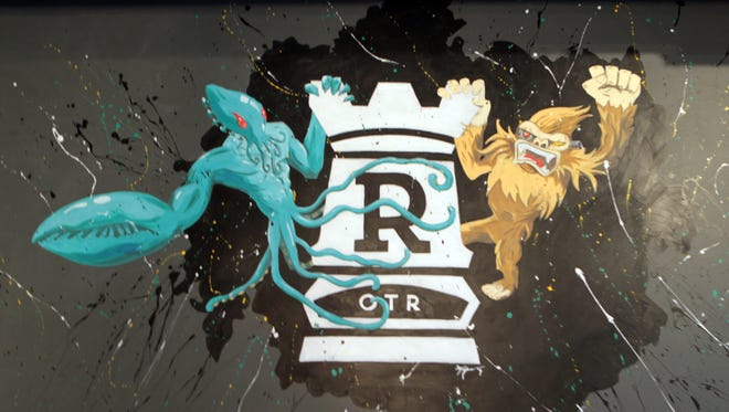 The logo of Rook,  a board game parlor/bar/restaurant in the Over the Rhine, with characters hanging on it.