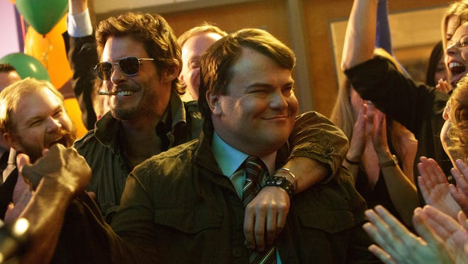 "This image released by IFC Films shows James Marsden, left, and Jack Black in a scene from ""The D Train."" (Hilary Bronwyn Gayle/IFC Films via AP)"