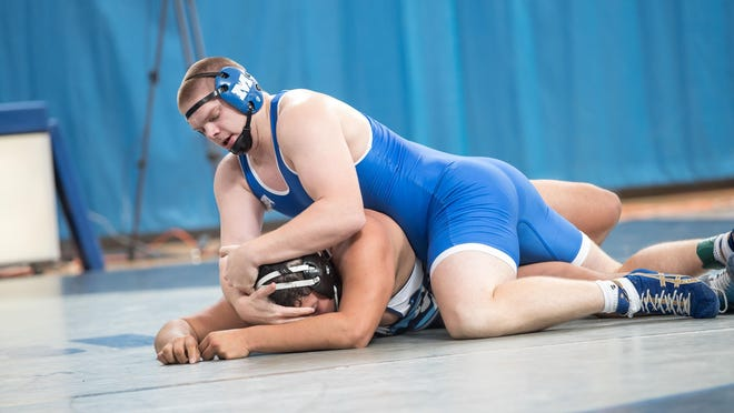 Evan Betz controls an opponent while wrestling for Millikin University.