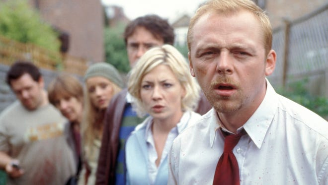 "Simon Pegg (right) confronts a zombie apocalypse (with help from, starting at left, Nick Frost, Penelope Wilton, Lucy Davis, Dylan Moran and Kate Ashfield) in Edgar Wright's horror comedy, ""Shaun of the Dead."""