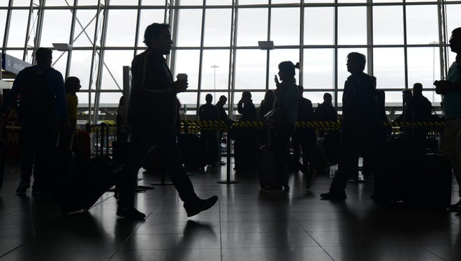 People are seen at John F. Kennedy International Airport's Terminal 4 international arrivals in Jamaica, N.Y., on Oct. 11, 2014.