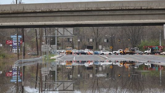 Vehicles are re-routed around flooding along Route 59 in West Nyack by the Palisades Center on May 1.