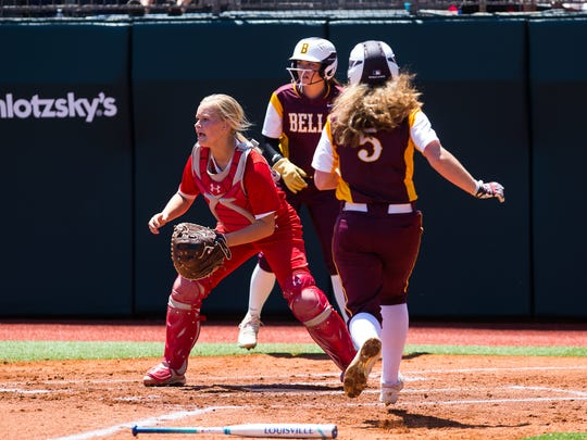 Bells Mia Moore runs home to score during the first inning of their 2A state semifinal game against Albany.