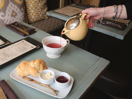 Tea and scones with clotted cream and raspberry jam