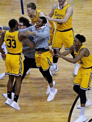The UMBC Retrievers celebrate beating the Virginia
