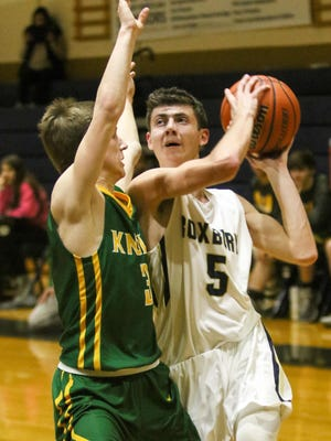Roxbury's Brandon Lessig goes to the basket as Morris Knolls' Christian Bornemann defends during the first half on Thursday.