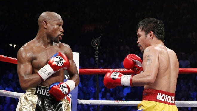 Floyd Mayweather (left) and Manny Pacquiao.