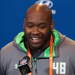 Mississippi offensive lineman Laremy Tunsil speaks to the media during the 2016 NFL combine in Indianapolis.