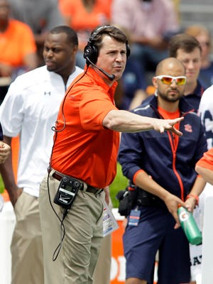 Auburn Tigers defensive coordinator Will Muschamp watches his squad during the A-Day game at Jordan-Hare Stadium.
