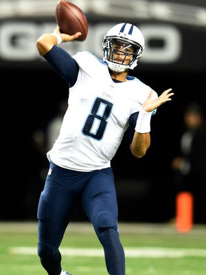 Titans quarterback Marcus Mariota (8) throws a pass during the first quarter of their against the Falcons game at the Georgia Dome Friday in Atlanta, Ga.