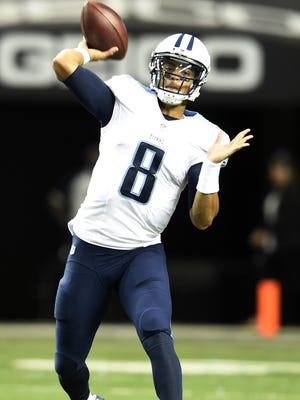 Titans quarterback Marcus Mariota (8) throws a pass during the first quarter of their against the Falcons game at the Georgia Dome Friday Aug. 14, 2015, in Atlanta, Ga.
