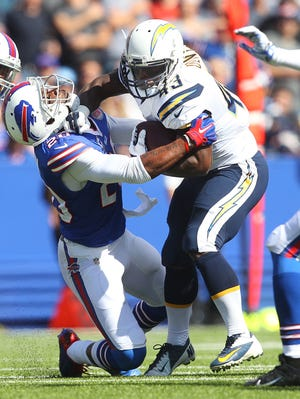 The Bills' Corey Graham, left, tries to tackle Chargers running back Branden Oliver.
