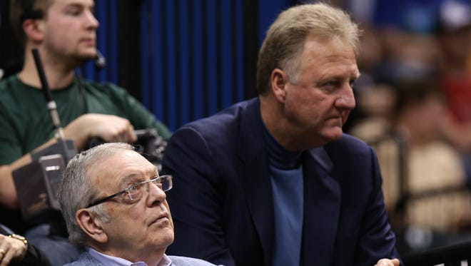 Donnie Walsh and Pacers president Larry Bird watch the game against the Dallas Mavericks at Bankers Life Fieldhouse October 18, 2014.
