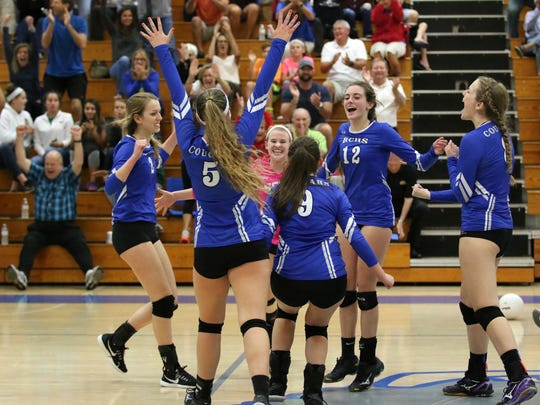 The Barron Collier volleyball team celebrates winning Set 2 of Thursday night's Class 7A regional semifinal against Fort Myers on their home court.