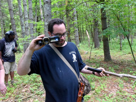Bigfoot researcher Daniel Benoit of Crimora captures video as he walks through the wilderness seeking signs and evidence of Bigfoot. The East Coast Bigfoot Research Organization searched the George Washington National Forest near Elkhorn Lake for evidence pointing towards the existence of Sasquatch during a weekend investigation on June 20, 2015.