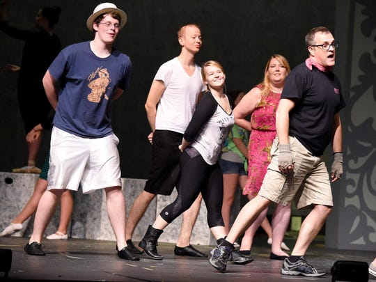 """Members of the ensemble cast join actor Jeff Ryman, aka. """"Bert,"""" in a dance number during rehearsal on stage at nTelos Theatre on July 21, 2015."""
