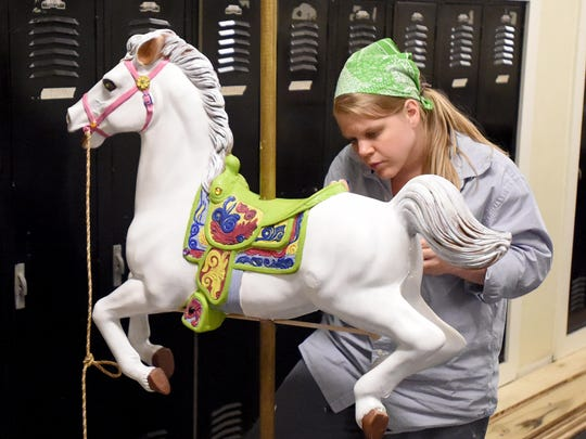 Kristin Gaffney paints the carousel horse during an evening work session. The horse is to be used by the character Mary Poppins.