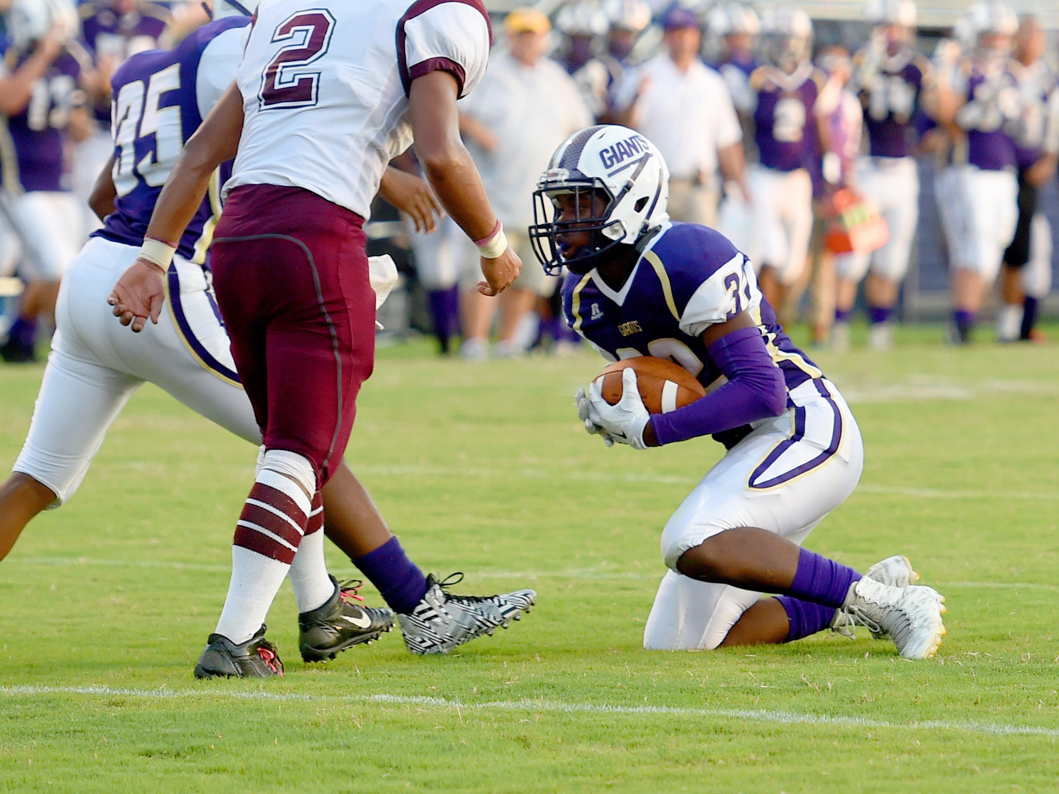 Waynesboro's Savion Jackson comes away with an interception during a football game played in Waynesboro on Friday, Sept. 11, 2015.
