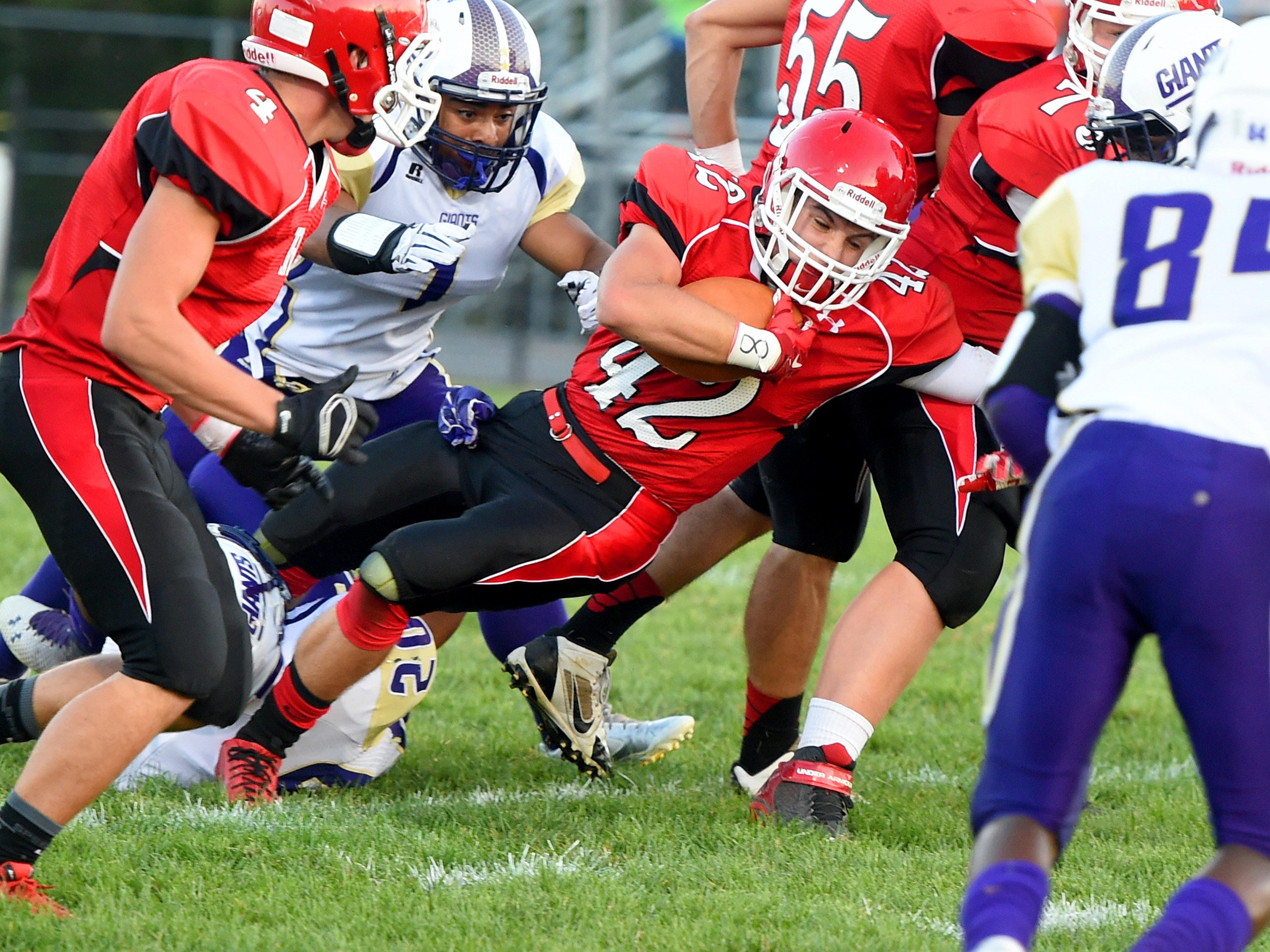 Riverheads' Colt Miller is brought down with the ball during a football game in Greenville on Friday.