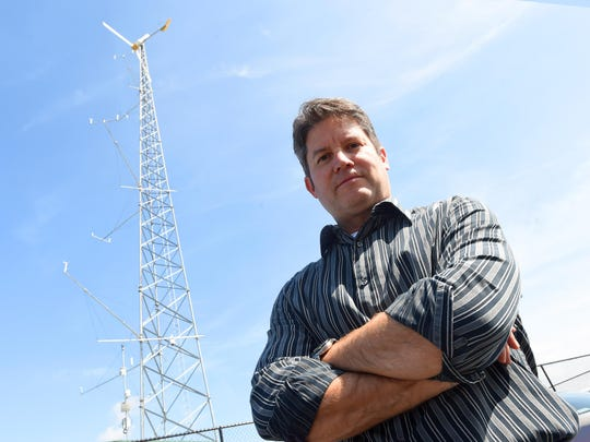 Jonathan Miles serves as director as well as research, Development, & Commercialization Coordinator for the Virginia Center for Wind Energy at James Madison University in Harrisonburg. He is photographed at the center's Small Wind Training and Testing Facility on the school's campus Sept. 23, 2015.